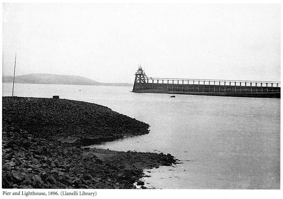 The photograph shows the pier that once existed at the end of the peninsula where the bombing took place